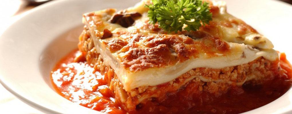 Enjoy our classic Lasagna paired with red wine!
